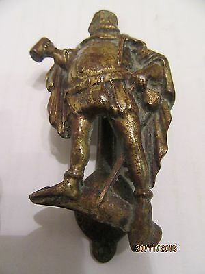 Ancient Brass Door Knocker with corpulent man drinking ale - a la Henry V111