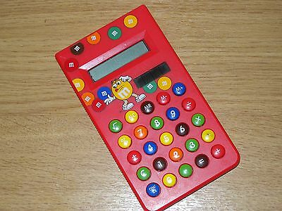M & M's collectable early solar red calculator.free p&p.