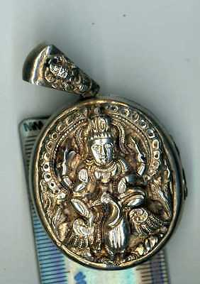 unmarked SILVER INDIAN LOCKET shows A GODDESS OR GOD ON THE FRONT