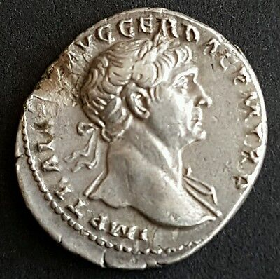 Silver denarius of the Roman emperor Trajan.Pax setting fire to pile of arms