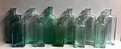 Eleven Vintage Quality Embossed Aqua Glass Chemist Bottles Great For Display.