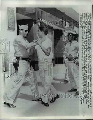 1961 Press Photo Dominican Police Arrest a Youth during Cab Drivers Strike