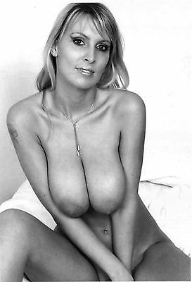 1960s Nude pinup squeezing monumental breasts with he arms 8 x 10 Photograph