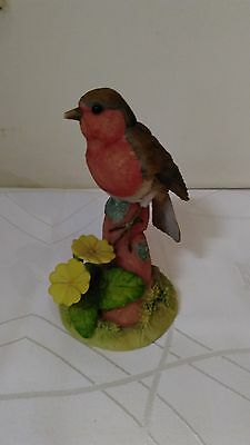 Teviotdale Robin on a branch with primroses D Edlmann 1994