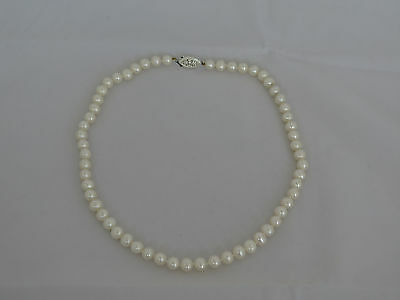 """Vintage 18"""" Strand of 7.5mm Pearls with a Sterling Catch"""