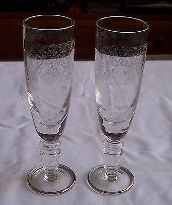 A Pair of Elegant,Etched Crystal Champagne Flutes Silver gilded Height 20 cm