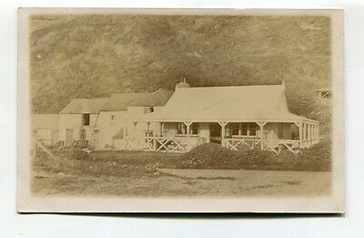 Unknown rural bungalow & nearby houses - old real photo postcard