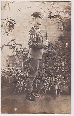 WW1 ANZAC real photo postcard Australian soldier with sword, unused