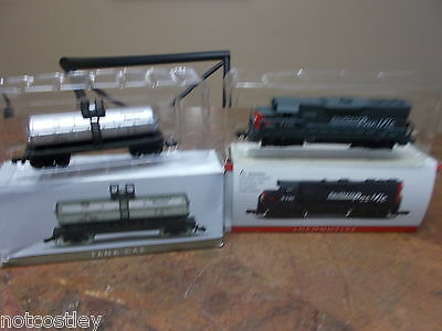 Southern Pacific Tank Car and Locomotive Never Played with still in box!!