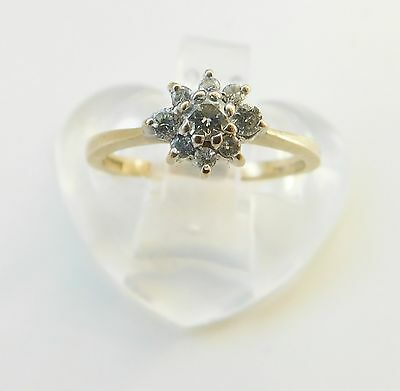 A SOLID 9ct GOLD 25 POINT DIAMOND CLUSTER RING