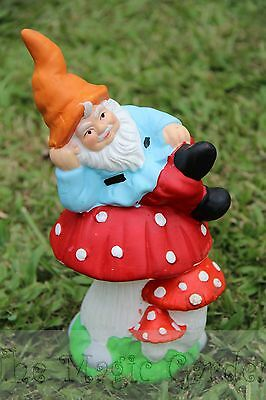 Gnome lying on a mushroom cement plaster garden ornament latex molds moulds