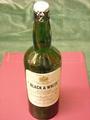 """1960's """"BLACK & WHITE"""" SCOTCH WHISKY BOTTLE WITH METALLIC CUP. EMPTY."""