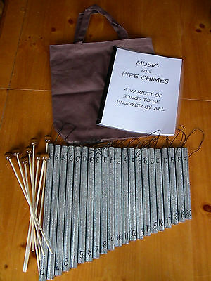 Pipe chime sets with mallets and music book