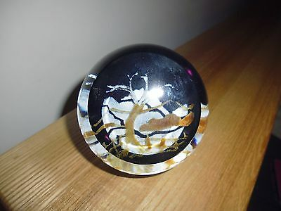 """Signed Caithness glass paperweight """"Winter Scene"""", mainly purple."""