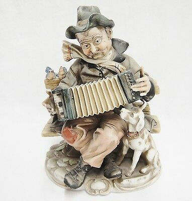 "Porcellane d'Arte Accordian Player Figurine with Dog and Bluebirds 8"" Very Good"