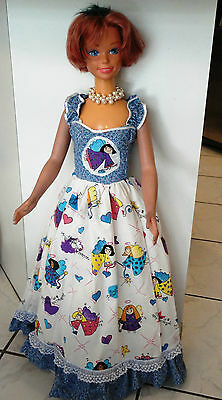 My size Barbie gown with angels print trimmed in ruffles & lace.