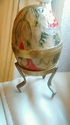 Brass egg shaped ornament on stand