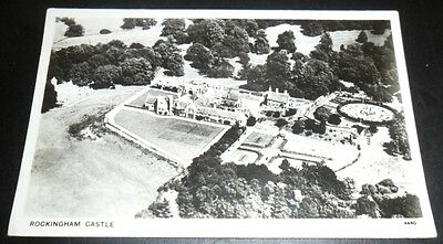A real B/W air photograph postcard of Rockingham Castle, RPC