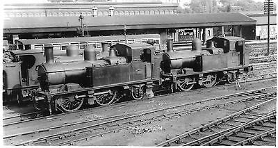 Photo Ex GWR 0-4-2T Nos 4805 and 4851 at Exeter shed yard