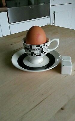 Crossword Boxed Egg Cup in a Saucer with Salt and Pepper Cubes