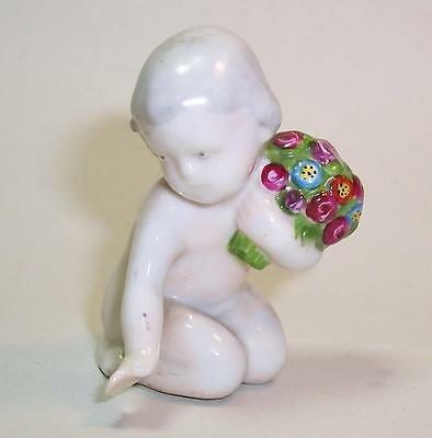 Vintage/Antique Ceramic BABY Holding BOUQUET of FLOWERS Sitting Nude Child