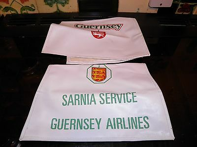 2 old Guernsey airlines headrest covers