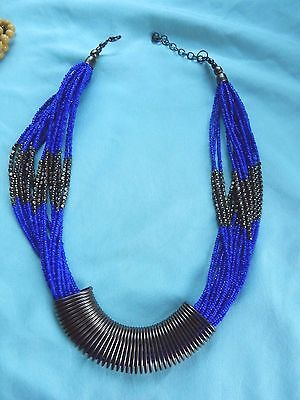 Vintage Blue beaded 18 strand coil metal NECKLACE - bought in South America