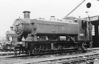 Photo Ex GWR 0-6-0T No 8489 seen here at Radyr shed yard on 30/5/54