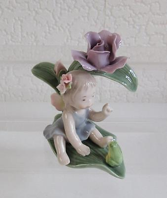 Porcelain Flower Baby Fairy on Lily Leaves looking at Frog with Butterfly Wings