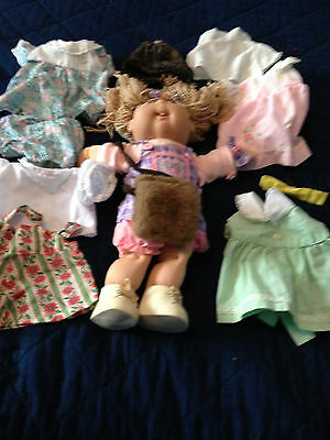 Cabbage patch doll and outfits, muff and hat