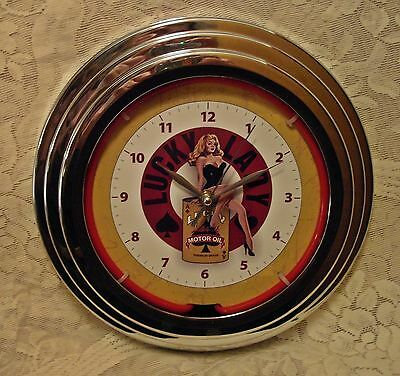 """NEON WALL CLOCK 12"""" Round ~ LUCKY LADY MOTOR OIL~ New In Box ~ Pin-Up Girl"""