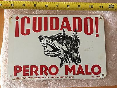 Vintage Tin Sign Cuidado Perro Malo Caution Dog 1983 Four Paws Products Islip NY
