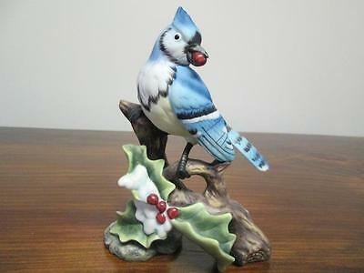 """Blue Jay Figurine Sitting On Branch  Berry In Beak Nice Gently Used 6 """" Tall"""