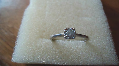 9ct white gold and .10ct solitaire diamond ring size L