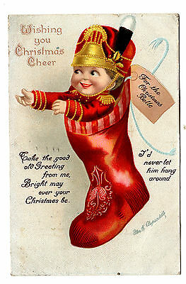 1915 Signed Clapsaddle Christmas  Postcard International Art Baby In Stocking