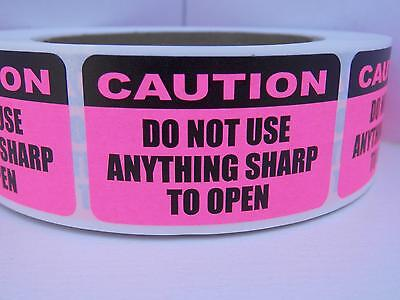 CAUTION DO NOT USE ANYTHING SHARP TO OPEN fluor pink Sticker Label 500/rl