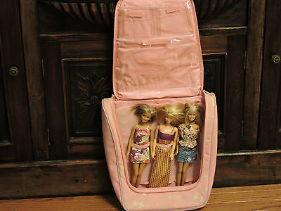 (Lot 3) Three Barbie Dolls and carrying case