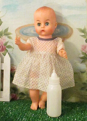 Baby doll similar to Ginnette or Baby Susan 1950s mid-century 8 in dress & bottl