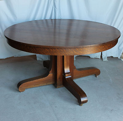 Antique Round Oak Mission style Dining Table – 54 inches diameter and 4 leaves