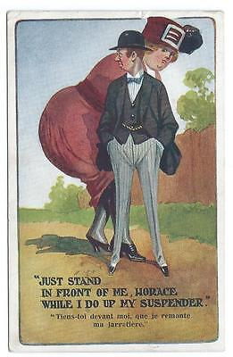 1918. Large Woman Trying To Hide Behind Very Thin Husband. Inter-Art Clr Pc