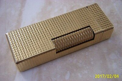 A DUNHILL GOLD PLATED ROLLAGAS CIGARETTE LIGHTER  c. MID 1960'S