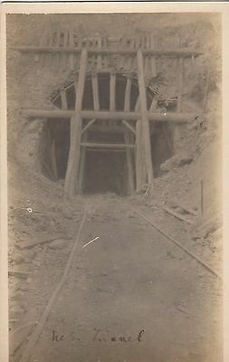 Real photo postcard to mine entrance from mine in Australia showing rail tracks