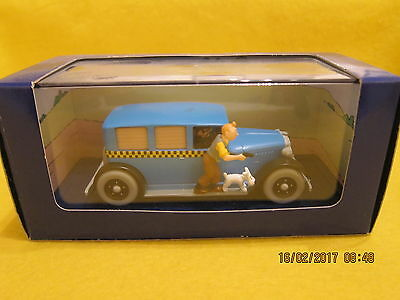 A Model Of 'atlas Tintin Car- Scale 1/43 - The Chequered Taxi-Tintin In America.