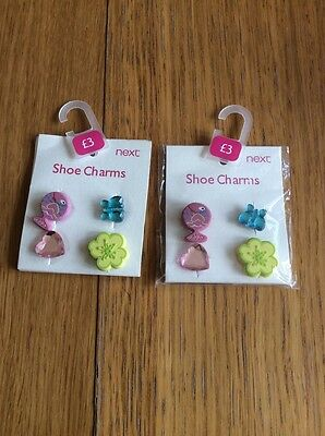 two packs of shoe charms by next