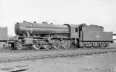 Photo Ex WD 2-8-0 No 90563 seen at Southall shed yard on 4/11/62 PHG
