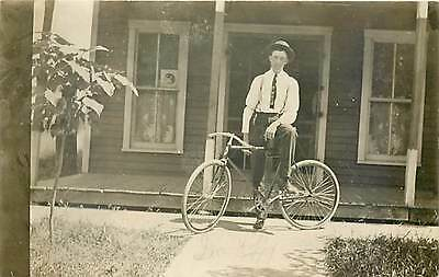 Bicycle, RPPC, Man Posing in front of a House near the Porch
