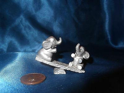 SPOONTIQUES MINI PEWTER ELEPHANTS on SEESAW