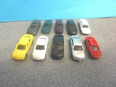 Bargain 10 Fixed Wheel Cars 24mm Long for your model Train Layout: New: