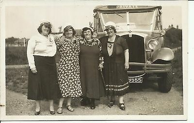 Four ladies in front of a charabanc, otherwise unidentified.