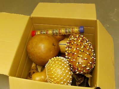 box of assorted percussion items  london beaded gourd tongue drum shaker african